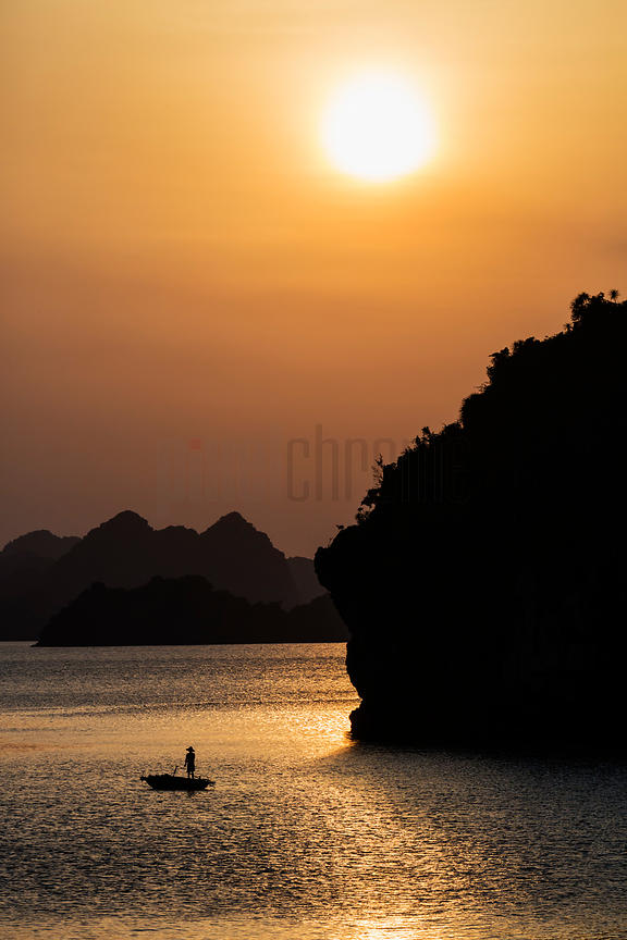 Fisherman in Halong Bay at Sunset
