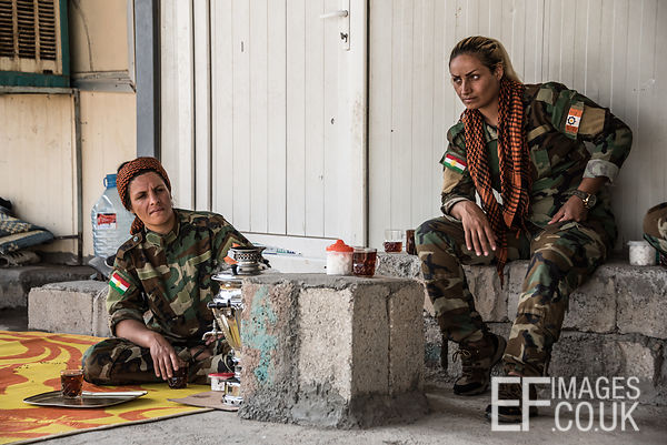 PAK (Kurdistan Freedom Party) female fighters taking a tea break at her base north of Hawija, where Kurdish Iranian fighters ...