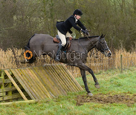 Adrienne Collie jumping a hunt jump at Peakes - The Fitzwilliam Hunt visit the Cottesmore at Burrough House