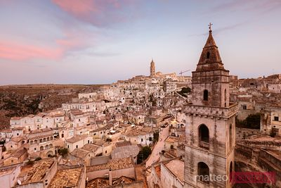 San Pietro Barisano church and Sassi di Matera at sunset, Italy