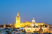 Cathedral of Seville with the Giralda tower at dusk, Andalusia, Spain