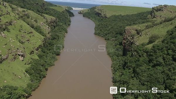 Aerial shot of the mouth of a river going into the ocean KwaZulu Natal South Africa