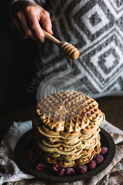 WAFFELS WITH RASPBERRIES ON A DARK BACKGROUND