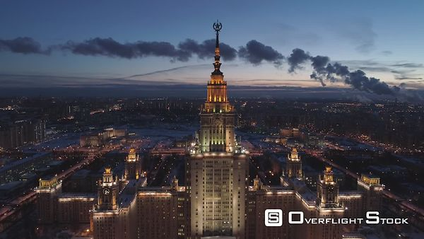 Moscow State University and Illuminated Moscow Skyline at Winter Evening. Russia. Aerial View. Drone is Flying Forward and Ap...