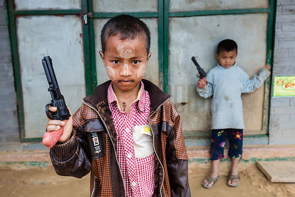 Portrait of Children with Toy Guns