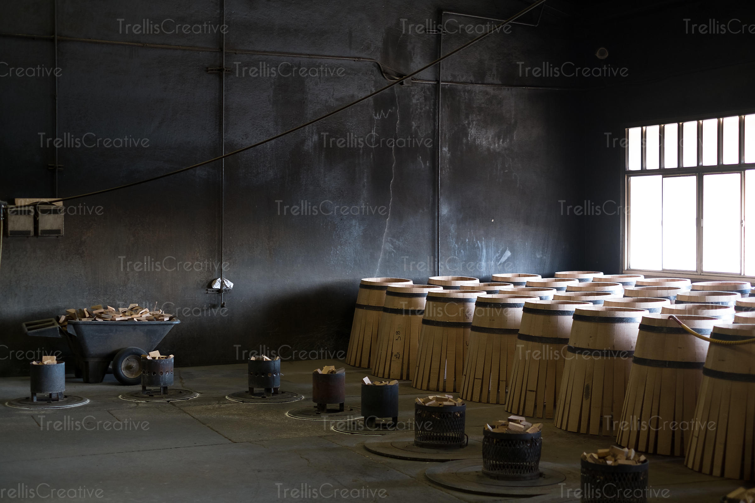 Oak wine barrels being built in a cooperage