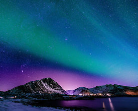 The northern lights over a village on Lofoten