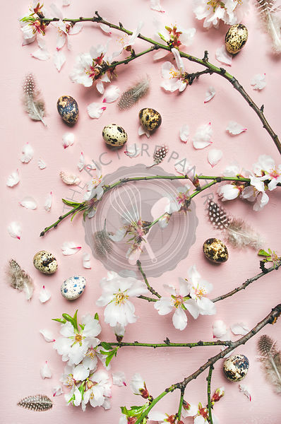 Easter background with eggs, almond flowers and feathers, vertical composition