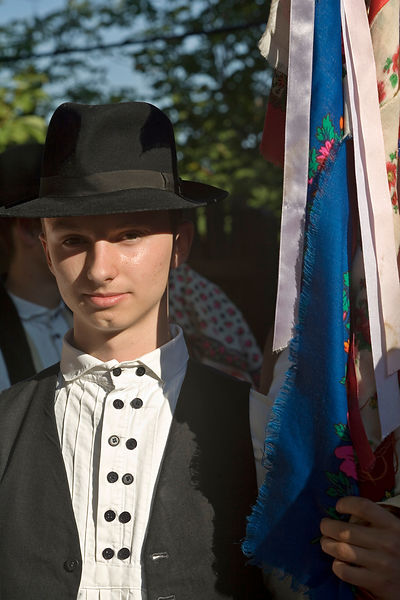 Hungary - Pecs - A youth in traditional costume holds a flag
