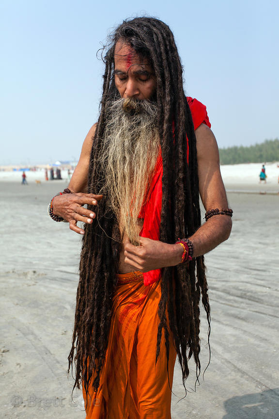 A sadhu (holy man) adjusts his waist-length dreadlocks at the Gangasagar Mela, a Hindu pilgrimage to Sagar Island in the Bay ...