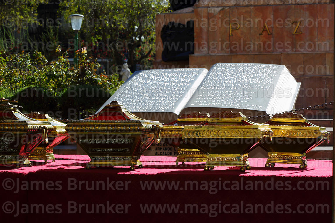 Caskets in honour of Juan Bautista Sagarnaga and other members of the Junta Tuitiva and carved stone book with text of the Pr...