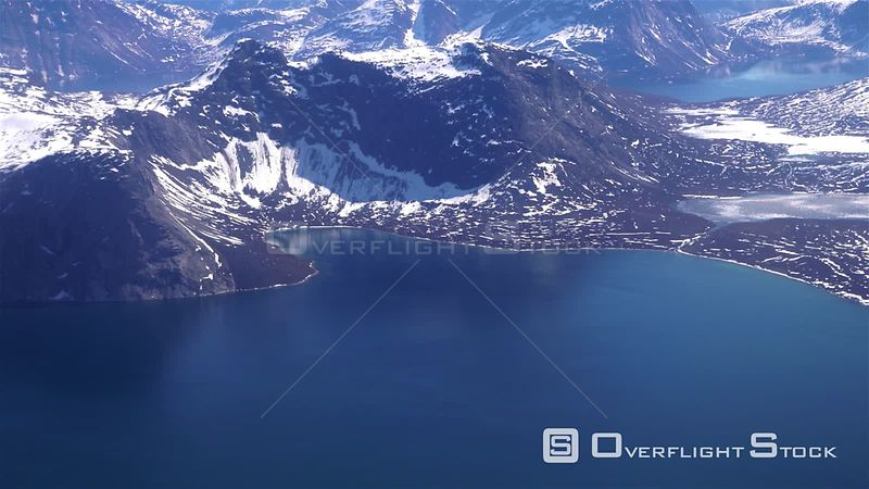 Deep blue ocean water under snowy mountains, Greenland