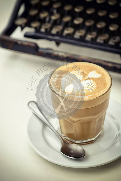 A Glass of Cafe Latte and typewriter