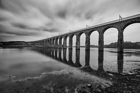 Royal border bridge over the river Tweed. with reflections in the river, against a cloudy sky, in black and white