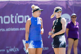 Julia Goerges (GER) and Xenia Knoll (SUI) wining against Sabine Lisicki (GER) and Eugenie Bouchard (CAN) the first round at t...