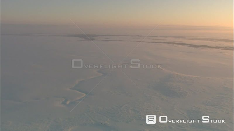 Flying over a caravan on the Siberian steppe in winter