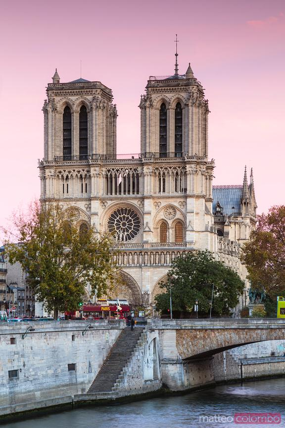 Pink sky over Notre Dame cathedral, Paris, France