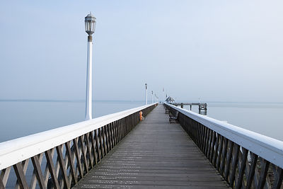 A misty, hazy Solent early one summer morning at Yarmouth, Isle of Wight. The pier is a commanding structure and provides a g...