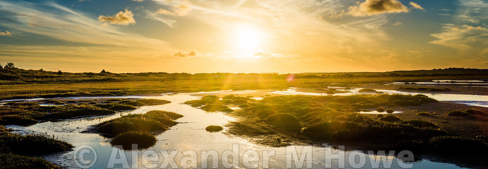Low Tide axcross Donegal Bay with a golden sunset across the water