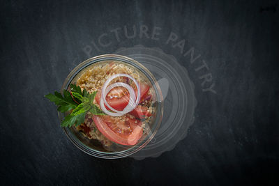 Couscous in jar on slate background. Top view