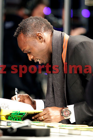Usain Bolt signs his autobiography book