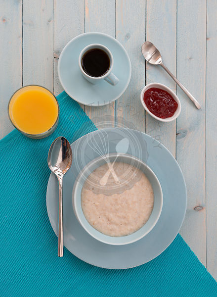 Porridge at breakfast, with coffee and orange juice.