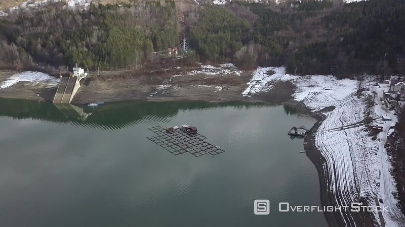 The Lake Lacul Rosu and Its Floating Fishermen Houses, Filmed by Drone at Sunset in Winter, Moldavia, Romania