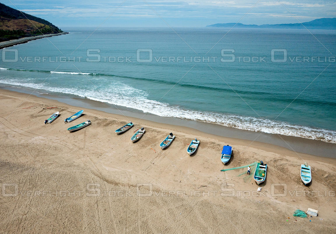 Fishing boats and the Pacific Ocean at Barra de Potosi, Mexico.