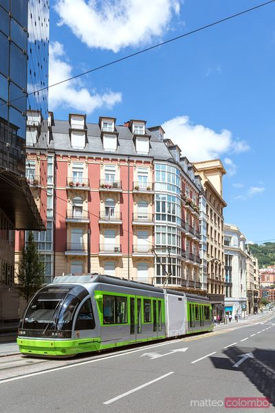 Typical tram in the streets of the city center of Bilbao, Spain