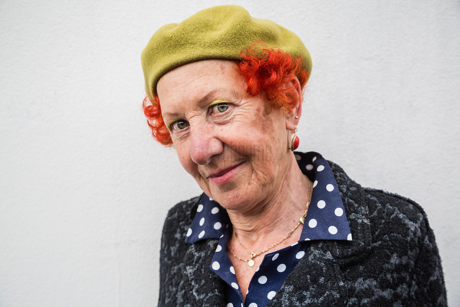 Portrait of a Woman with Orange Hair & a Green Beret
