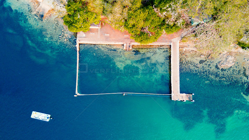 Overhead view of one of Sydney's many free coastal swimming pools.  The ocean is fenced with a free moving net. NSW Australia