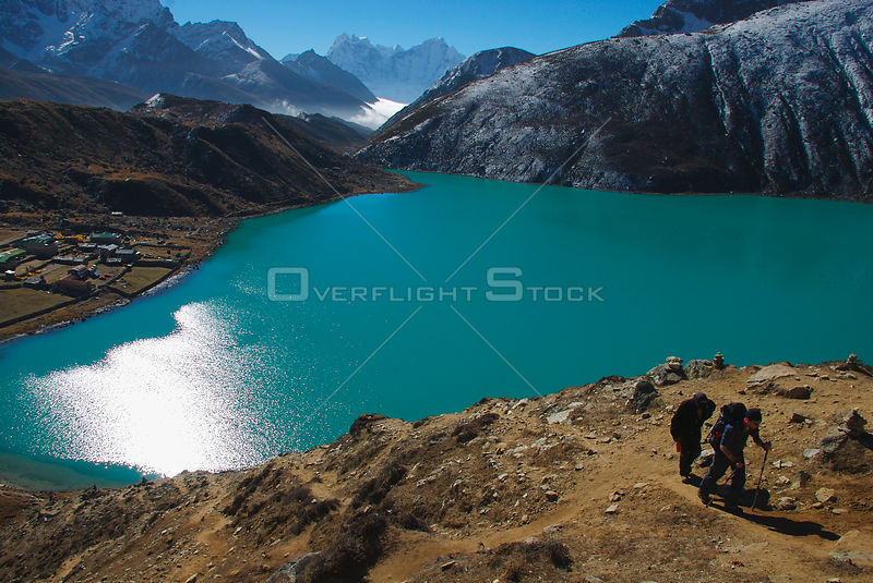 NEPAL Gokyo Peak -- A trekker and his guide ascend Gokyo Ri (Gokyo Peak) with the third lake of the spectacular Gokyo valley ...