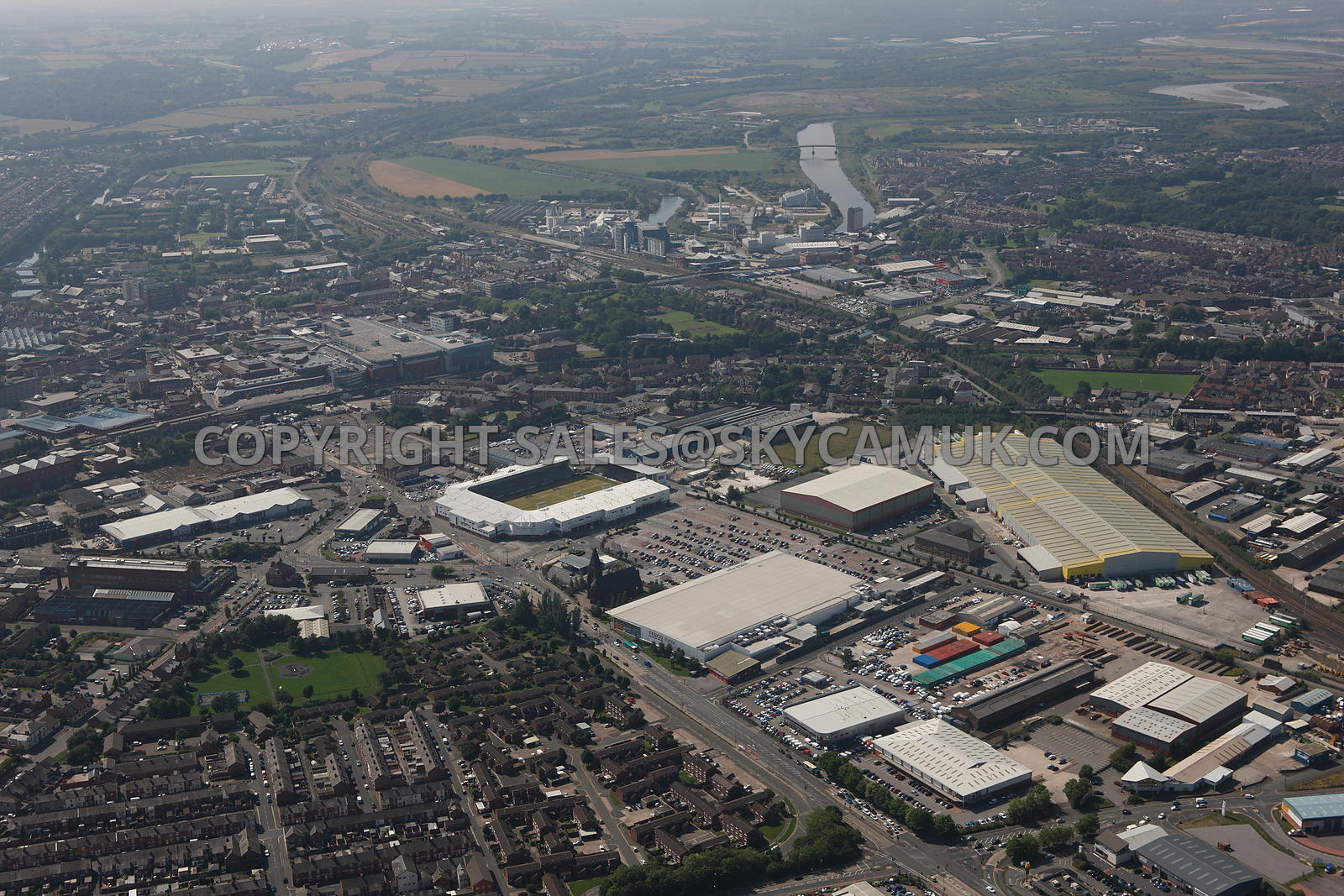 Warrington high level aerial photograph over looking Winnick Road towards Asda distribution centre Dallam Lane towards Tesco ...