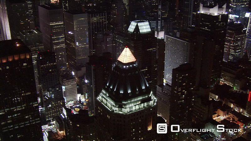 Close night flight over Times Square area.