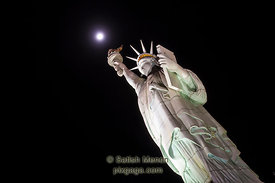 Statue of Liberty (replica) and moon, Las Vegas, NV, USA