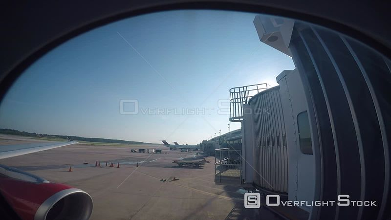 Timelapse of airport through a plane window