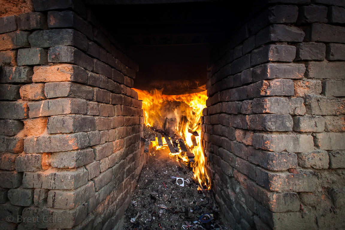 Primitive furnaces in the East Kolkata Wetlands near Bantala burn scrap leather from handbag factories, Kolkata, India. The f...