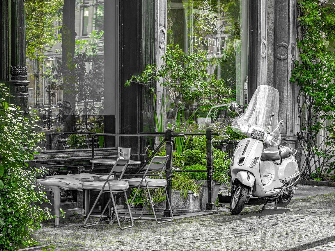 Scooter parked by the street cafe, Amsterdam
