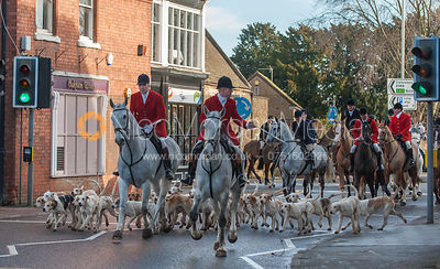 Robert Medcalf and Andrew Osborne lead the Cottesmore hunt hounds down Oakham High Street