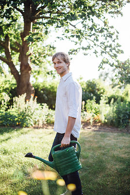 Man with watering can in garden