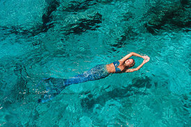 Mermaid in clear water of tropical island, Northwest Point, Providenciales, Turks & Caicos Islands