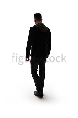 A Figurestock image of a mystery man, in silhouette, walking away – shot from eye level.