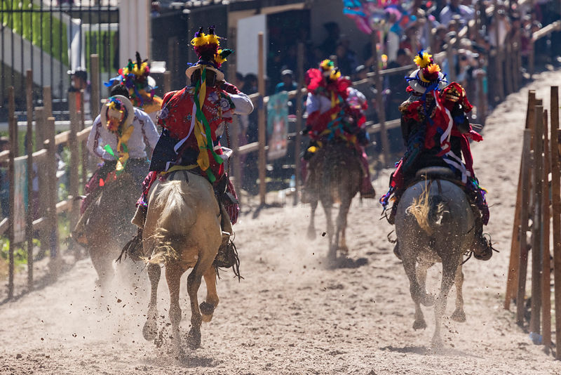 Riders in the Annual Day of the Dead Horse Race at Todos Sants Cuchumatán.