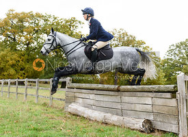 Gemma Redrup jumping a hunt jump near Temple Hill.