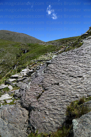 Symmetrical ripple marks in inclined strata next to section of Pre-Hispanic Inca Trail below Abra Calderillas pass, Cordiller...