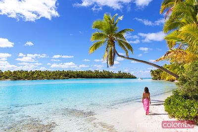 Woman walking on beach, One Foot Island, Cook Islands