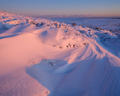 Bank of snow in early sunlight - Haytor, Bovey Tracey, Devon UK
