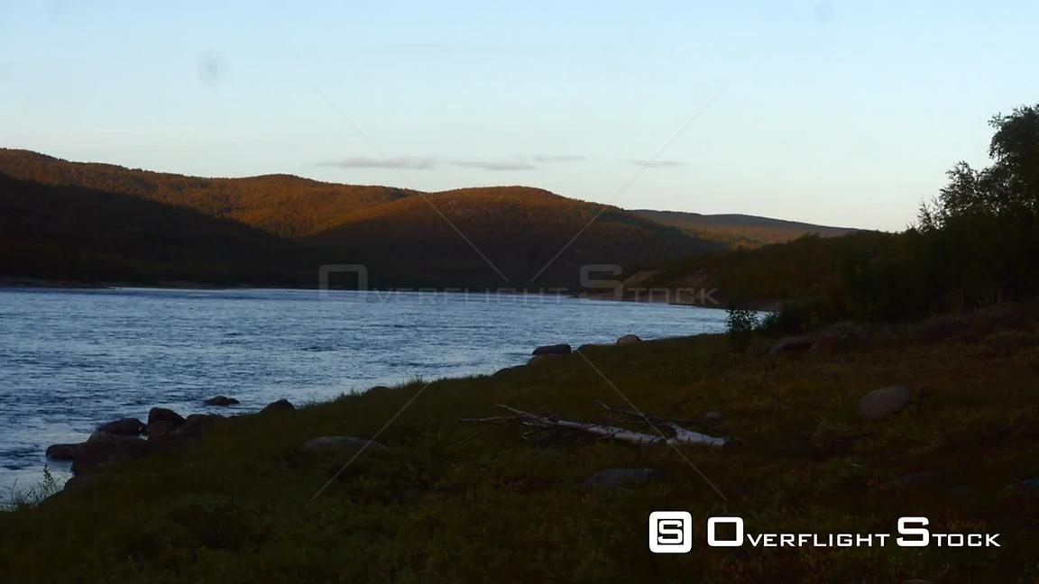 Autumn River, Time Lapse View of Tenojoki River at the Border Between Norway and Utsjoki Town, on a Sunny Autumn Evening Dawn...