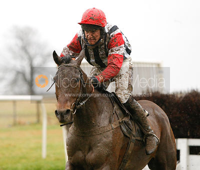 Mud-Spattered jockey