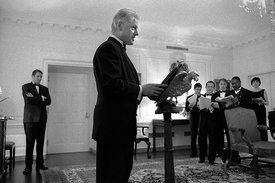 President William Clinton reads through a speech in front of his speech writers moments before the White House Correspondents...